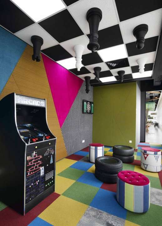 the-chess-pieces-and-tire-ottomans-are-pretty-random-but-the-arcade-games-look-fun